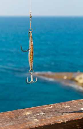 color image fish hook: beautiful bait for fishing close-up