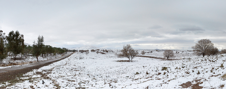 in the heights: road and snow in the Golan Heights in Israel Stock Photo