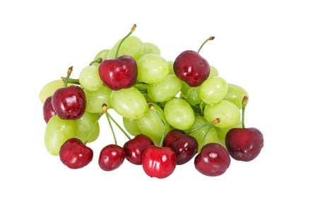 healthy economy: sweet cherry and green grapes on a white background