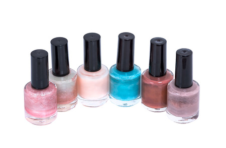 perfumery concept: different and beautiful nail polish on a white background Stock Photo