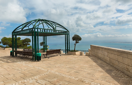 pergola: pergola with bench against a background of clouds in Haifa