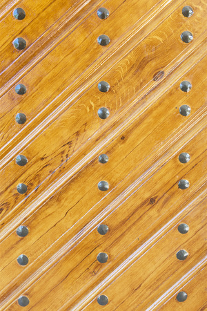 rivets: Background wooden doors with rivets Stock Photo