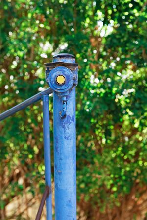 bell button on an iron post