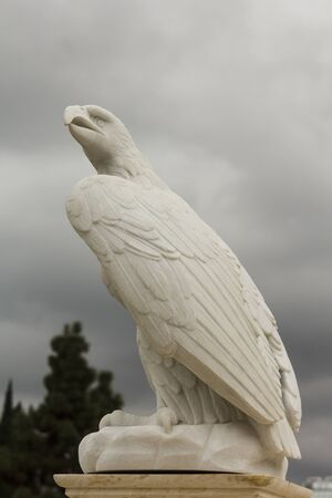 Eagle made of stone on the sky background
