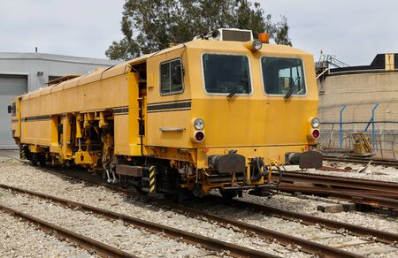 yellow railway locomotive repair