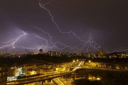 beautiful lightning in the night sky over Haifa Imagens