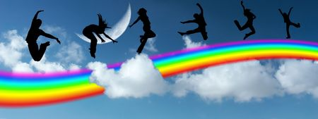Silhouettes of the people jumping on a rainbow in the sky