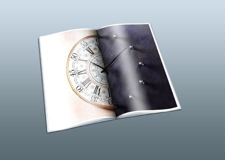 Old and new clock on pages in the book photo