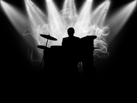 Black silhouette of the musician which plays on a scene photo