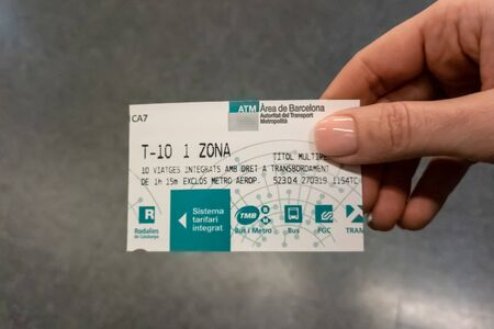 Female woman hand holding a subway ticket T-10 in Barcelona metro station in Catalonia, Spain.
