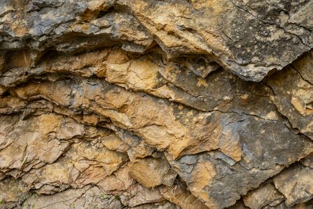 Background texture of a cracked triangle rock in a natural park congost de Mont-rebei Monrebey in Spain.