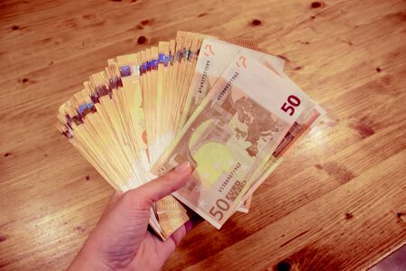 Female caucasian woman hand holding many euro banknotes Stock fotó