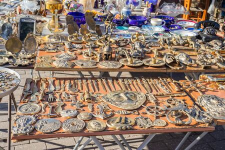 Bronze and metal objects sold on a street flee market in athens greece