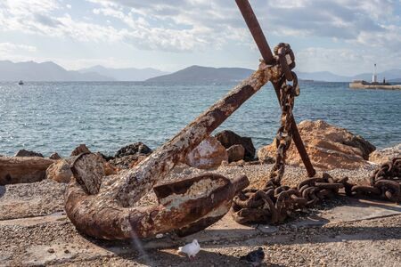 Rusty old anchors on the harbour of aegina island in greece