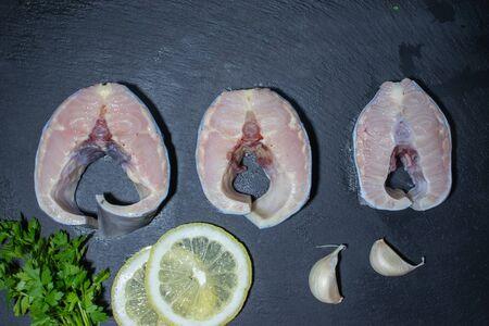 Fresh tasty raw fish steaks. Luxury sturgeon with lemon