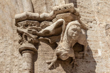Gothic gargoyle bas relief on an ancient historical building in Valencia Stock Photo