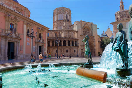 Square with a fountain in front of Gothic Valencia Cathedral