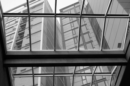 Modern apartment building viewed through glass roof of a lobby Banque d'images