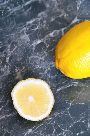 The cut lemon on an interesting blue-green background Stock Photo - 11658367
