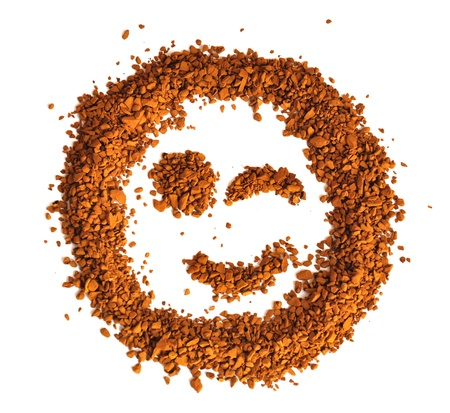 The smile made of coffee, with a winking eye, is isolated on a white background photo