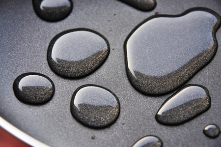 nonstick: Some the big drops of water on a new frying pan Stock Photo