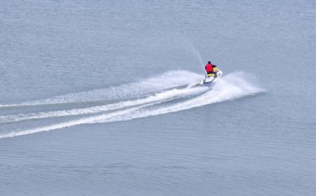 power boat: The person goes on the water scooter on the sea Stock Photo