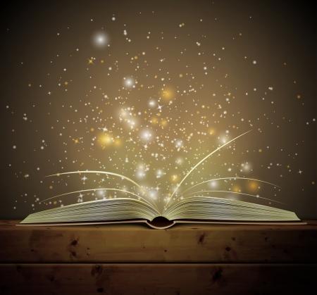 Aperto libro magico con la luce