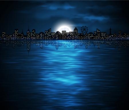 luz de luna: Vista nocturna de la ciudad de la costa con la luna creciente