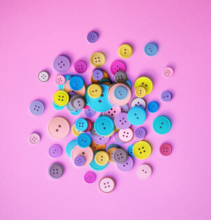 Pile of colorful sewing buttons on pink background, eps 10 Ilustrace