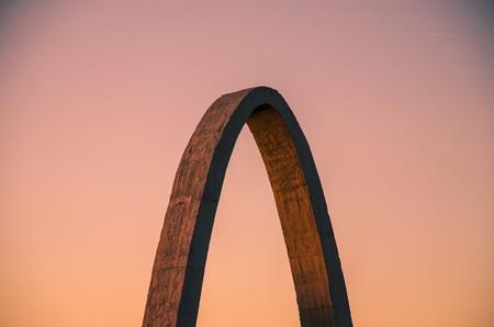 remuneraciones: Unfinished construction arc With the sunset background Foto de archivo