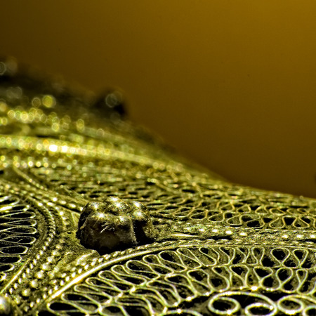 scheide: Macro shot for details of ornaments on a daggers scabbard surface.