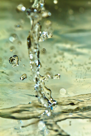 High speed abstract and macro shot for splashing water with droplets. Stock fotó