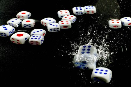 Stroboscopic shot for dice falling into water - part of series. 版權商用圖片
