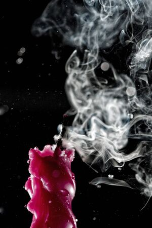 High speed shot for water being sprinkled over a lighted red candle. Part of series. Stock fotó