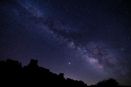 beautiful milky way and stars with the silhouette of the zafra castle in Guadalajara province of spain Banque d'images