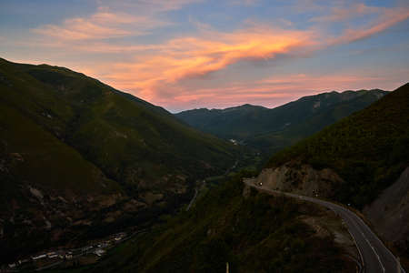 Beautiful sunset in the mountains south of Asturias with the road and orange mountains, Spain