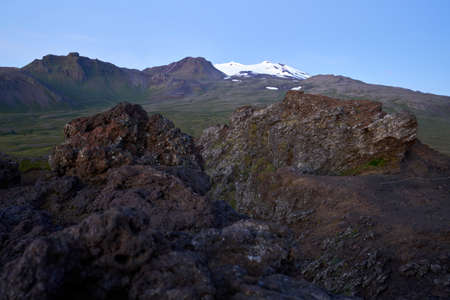 Beautiful view of the saxholl crater rock path in the foreground and with the Snæfellsjökull glacier in the distance on the island of Iceland