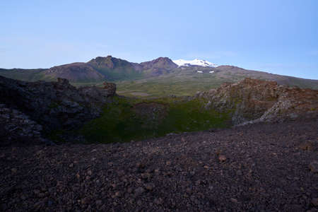 Beautiful view of the saxholl crater with the Snæfellsjökull glacier in the distance on the island of Iceland