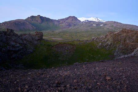 iconic view of saxholl crater with Snæfellsjökull glacier in the distance on the island of Iceland