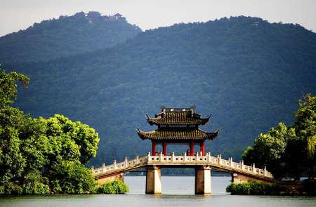 dynasty: a very famous pavilion bridge-yu dai qiao  jade belt  - in west lake, hangzhou, china was built in song dynasty and rebuilt in qing dynasty
