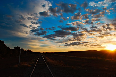 railaway tracks glowing in the setting sun Stock Photo - 8567758
