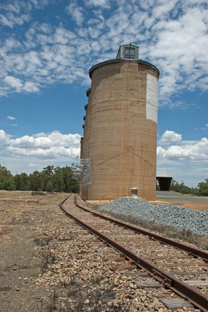 a railway track with grain silo towers photo