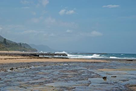 telegraph hill: men fish off rocks and waves crashing onto shore