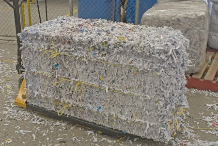 a square bale of shredded paper for recycling photo