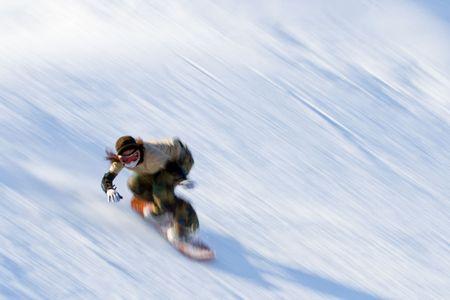 Rapid movement Snowboarding enthusiasts Stock Photo