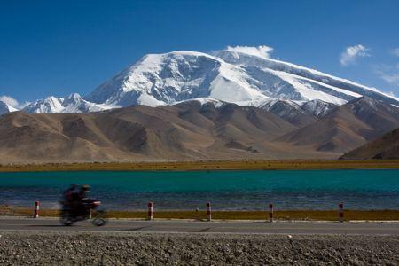 ata: Ata peak plateau under the road motorcycle Stock Photo