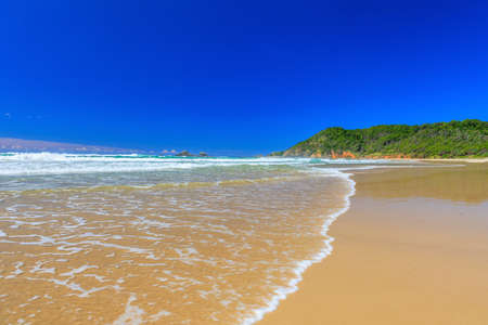 Photo taken over the beach of Byron Bay in Australia during the day in the sunshine from a ground perspective in March 2015