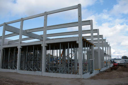 Construction site with precast concrete columns, beams and walls
