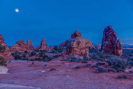 Panoramic picture of impressive sandstone formations in Arches National Park at night