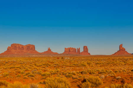 Panoramic pictures of rock formations in the evening sun in the Monument Valley National Park